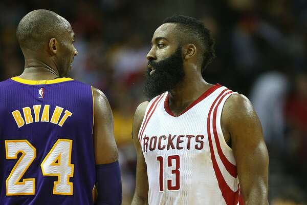 Houston Rockets guard James Harden (13) and Los Angeles Lakers forward Kobe Bryant (24) wait in the backcourt during a free throw in the first half of NBA game action between LA Lakers and Houston Rockets at Toyota Center on Saturday, Dec. 12, 2015, in Houston. ( Elizabeth Conley / Houston Chronicle )