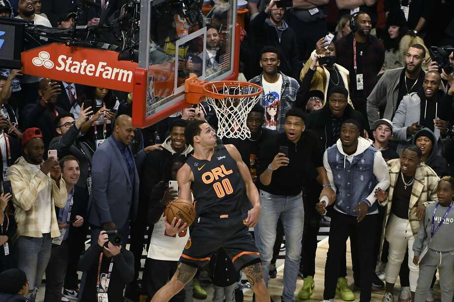 """Aaron Gordon (Mitty) of the Orlando Magic notched perfect """"50"""" scores on each of his first five dunks in the slam dunk contest, but he didn't come away with the win in a controversial ending. Photo: David Banks / Associated Press"""