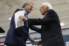 New York Mayor Bill de Blasio, left, greets Democratic presidential candidate Sen. Bernie Sanders I-Vt., after introducing him at a campaign event in Carson City, Nev., Sunday, Feb. 16, 2020. (AP Photo/Rich Pedroncelli)
