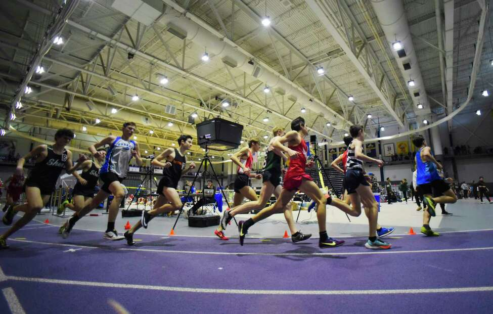 Boys competing in the 3200 meter race make their way around the track at the Section II Division I high school indoor track championships on Sunday, Feb. 16, 2020 in Albany, N.Y. (Paul Buckowski/Times Union)