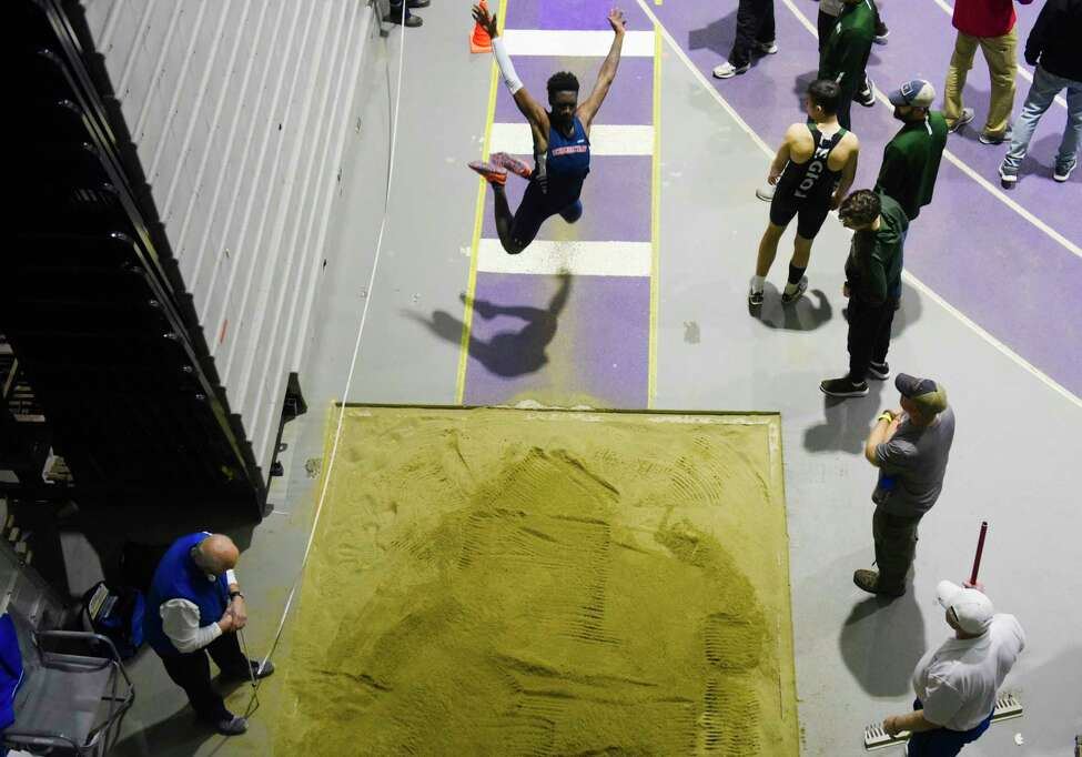 Malakai Myles of Schenectady High School launches himself through the air as he competes in the long jump at the Section II Division I high school indoor track championships on Sunday, Feb. 16, 2020 in Albany, N.Y. (Paul Buckowski/Times Union)