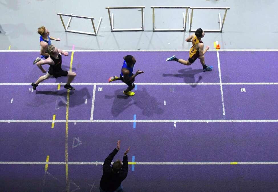 Boys competing in a heat of the 600 meter race run along the track at the Section II Division I high school indoor track championships on Sunday, Feb. 16, 2020 in Albany, N.Y. (Paul Buckowski/Times Union)