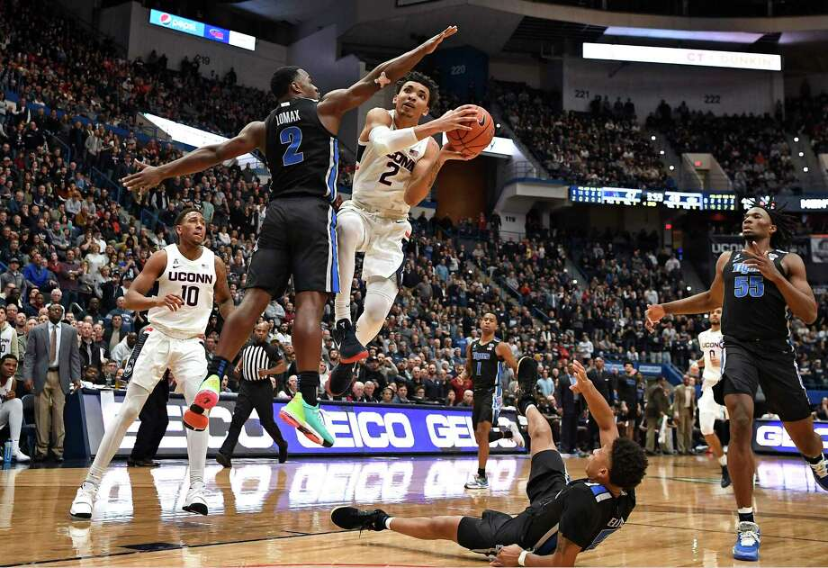 UConn's James Bouknight (2) is fouled by Memphis' Alex Lomax (2) as he goes up for a basket in the second half of an NCAA college basketball game, Sunday, Feb. 16, 2020 in Hartford. Photo: Jessica Hill / Associated Press / Copyright 2020 The Associated Press. All rights reserved.