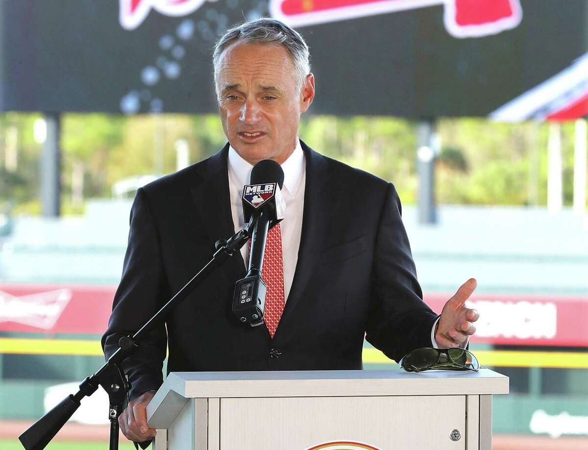 MLB commissioner Rob Manfred speaks to reporters Sunday in North Port, Fla., spring training home of the Atlanta Braves.