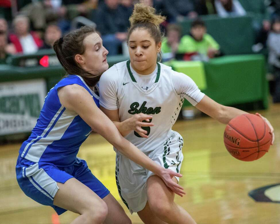 Shenendehowa senior Simone Walker drives to the basket in front of Saratoga junior Katie Cleason during a Suburban Council game at Shenendehowa High School on Tuesday, Feb. 11, 2019 (Jim Franco/Special to the Times Union.)