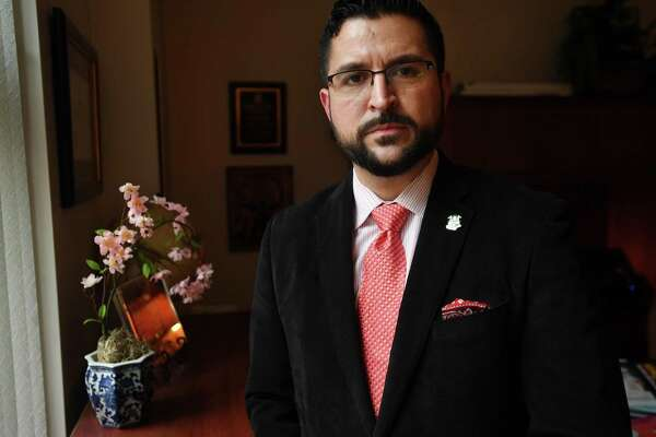 Steven Hernandez, executive director of the Commission on Women, Children, and Seniors, in his office in Hartford on Jan. 14.