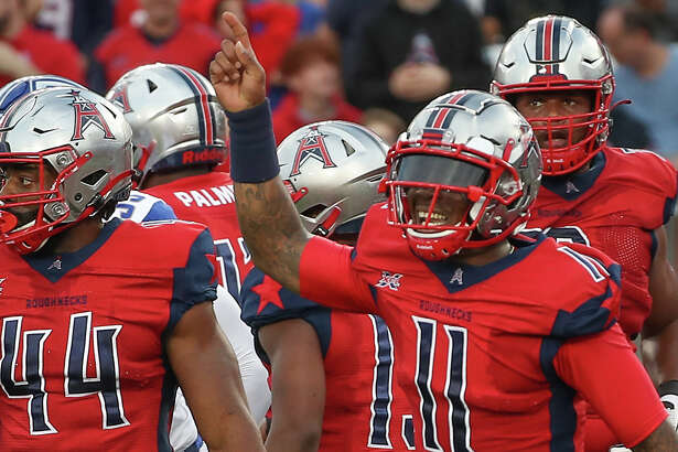 Houston Roughnecks quarterback P.J. Walker (11) reacts to the bench after a touchdown during the first quarter of an XFL football game at TDECU Stadium on Sunday, Feb. 16, 2020, in Houston.