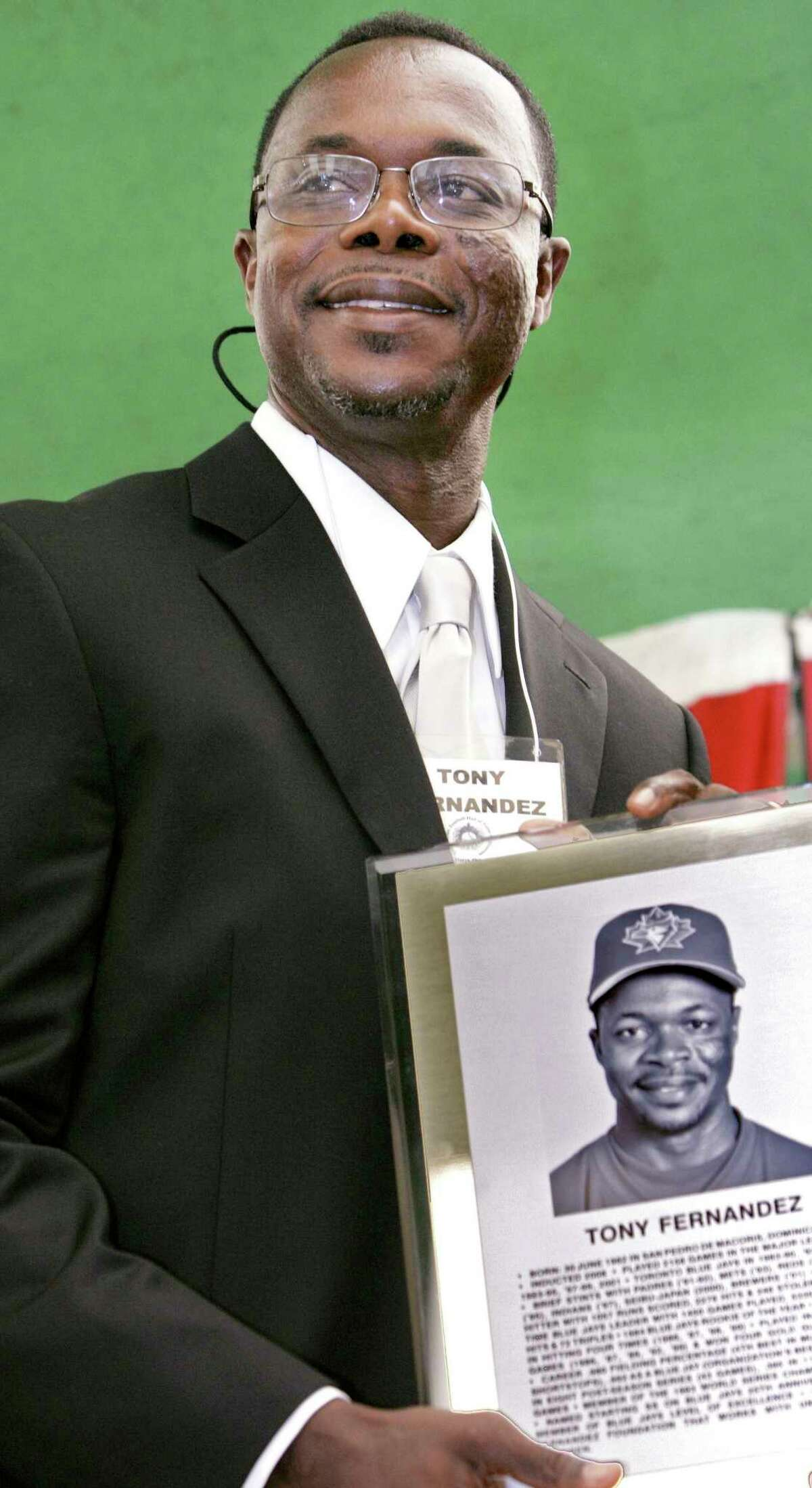 FILE - In this June 28, 2008, file photo, former Toronto Blue Jays player Tony Fernandez attends the Canadian Baseball Hall of Fame & Museum ceremony in St. Marys, Ontario. Former All-Star shortstop Fernandez remained on a life support system Sunday, Feb. 16, 2020, pending a decision by his family on how to proceed, the director of his foundation said. He had been in a medically induced coma, said Imrad Hallim, the director and co-founder of the Tony FernA!ndez Foundation. Fernandez was ill with a kidney disease for years and waiting for a transplant. (Ken Wightman, London Free Press/Canadian Press via AP, File)