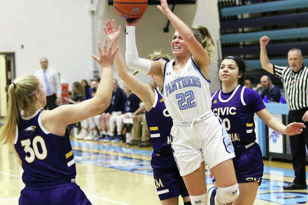Jersey's Clare Breden (22) gets between CM's Jenna Christeson (30), Tori Standefer and Kourtland Tyus (right) puts up a shot after drawing a foul on Tyus in the first half Thursday at Havens Gym in Jerseyville.