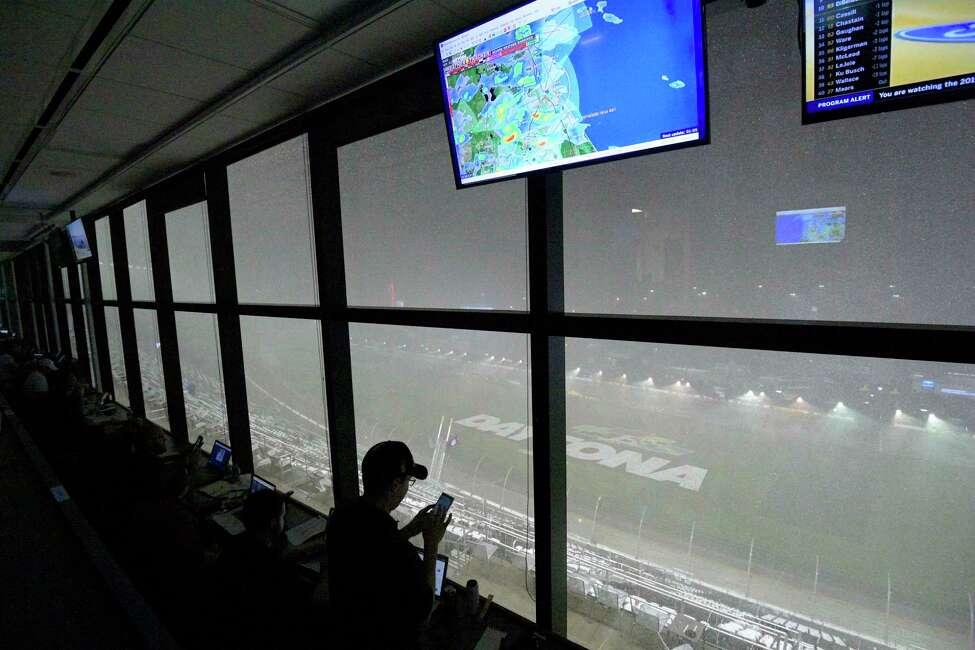 A downpour, as viewed from the press box, forces a postponement of the NASCAR Daytona 500 auto race at Daytona International Speedway, Sunday, Feb. 16, 2020, in Daytona Beach, Fla. (AP Photo/Phelan M. Ebenhack)