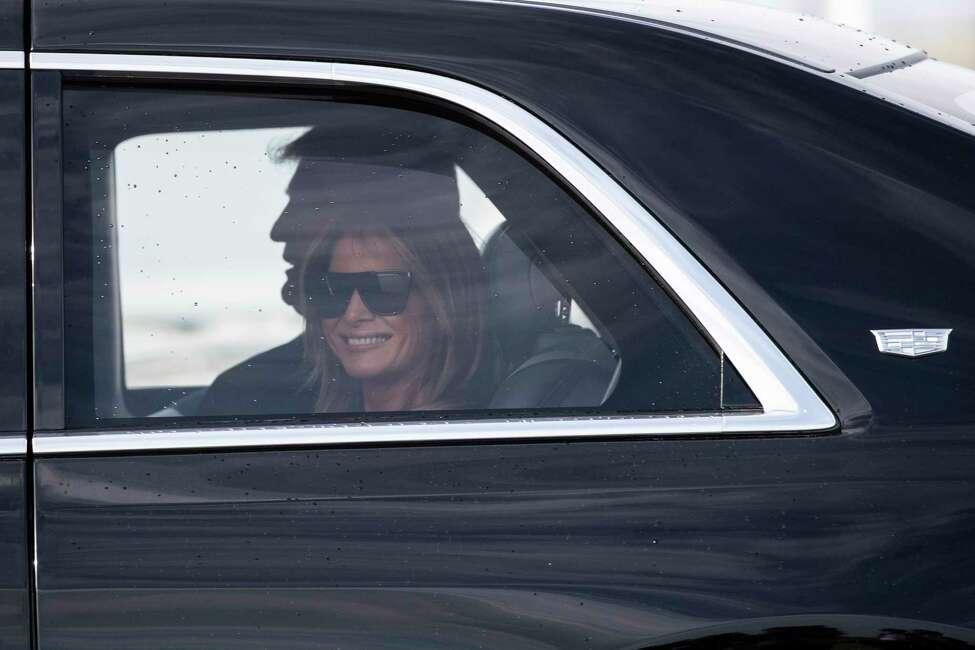 First lady Melania Trump smiles as they head to their planes at Daytona Beach International Airport, Sunday, Feb. 16, 2020, in Daytona Beach, Fla. Trump was at the NASCAR Daytona 500 auto race at Daytona International Speedway. (AP Photo/Alex Brandon)