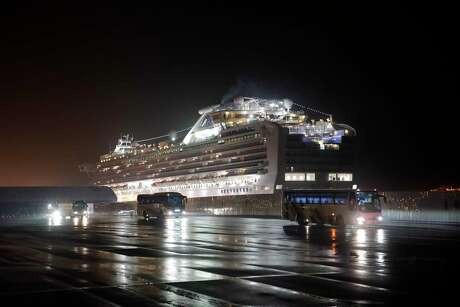 Buses carrying American passengers from the quarantined Diamond Princess cruise ship leave a port in Yokohama, near Tokyo, on Monday, Feb. 17, 2020. Health officials screened everyone before allowing them onto the U.S-bound flights, and no one showing signs of coronavirus was allowed to fly to the U.S.