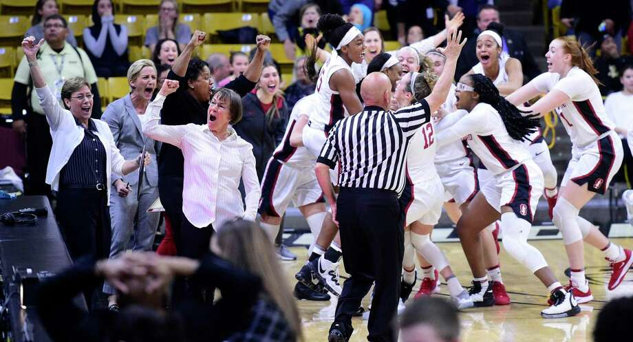 Stanford head coach Tara VanDerveer, with fist raised, celebrates Kiana Williams' game-winning shot. Photo: Cliff Grassmick / Boulder (Colo.) Daily Camera / 2020 Daily Camera, MediaNews Group