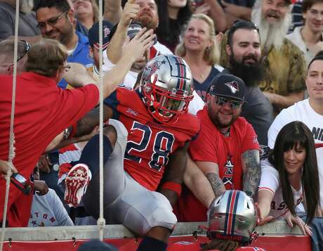 Roughnecks running back James Butler (28) becomes a face in the crowd after scoring a second-quarter touchdown in Sunday's 28-24 win over the St. Louis BattleHawks.