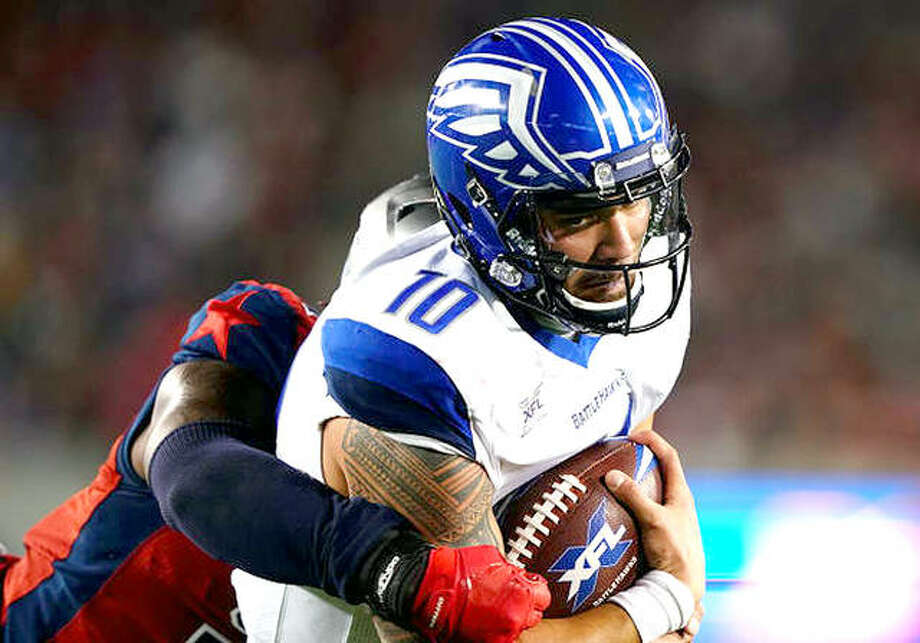 BattleHawks quarterback Jordan Ta'amu is brought down by a Houston Roughnecks defender Sunday in Houston, Ta'amu threw for 284 yards and three touchdowns while rushing for 32 and one score. Photo: XFL Photo