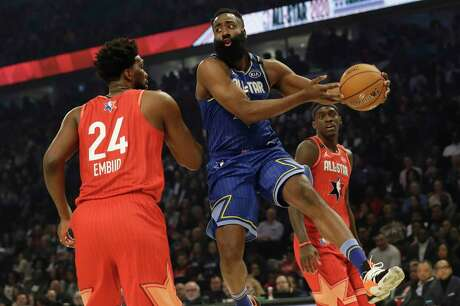 James Harden of the Rockets looks to pass during the first half of the NBA All-Star Game on Sunday. Harden finished with 11 points and six assists.
