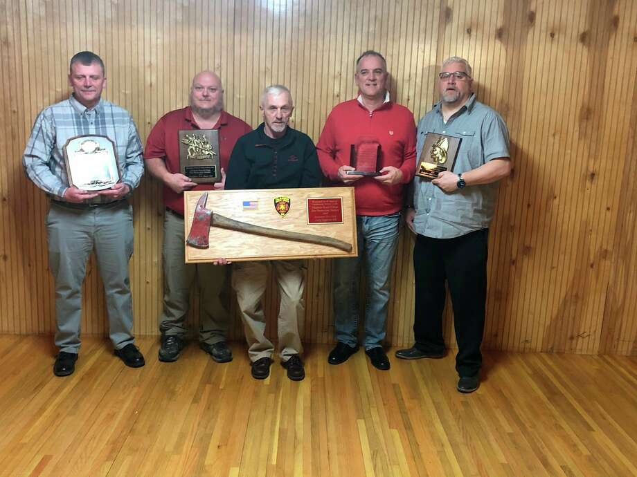 Scott Grice, left, received the Firefighter of the Year Award at the Gladwin Fire Department's thank you and awards dinner on Feb. 8. Receiving Years of Service Awards were, from left: Fred Shaver, 20 years; Larry Eagleson, 45 years; Greg Alward, 35 years; and Mike Brubaker, 15 years. Not pictured: Katie Brubaker, 5 years; Josh Reid, 20 years. (Photo provided)