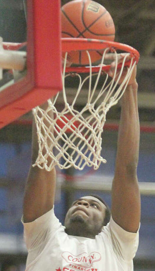 Jamal Garner participate in a slam dunk competition at the Illinois School for the Deaf in 2015. Photo: Journal-Courier