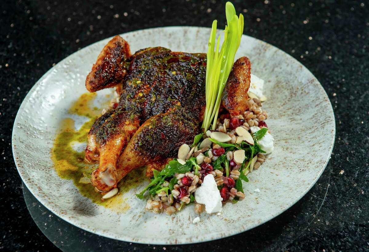 The Harissa Dusted Cornish Hen with faro, feta, arugula, toasted almonds, preserved lemon and salsa verde at Mark Holley's Davis St. at Hermann Park, Wednesday, Jan. 29, 2020, in Houston.
