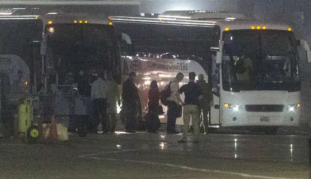 American passengers evacuated from the Diamond Princess cruise ship which has been docked in Japan in quarantine since Feb. 5 get on buses Monday morning, Feb. 17, 2020 after arriving on a Kalitta Air flight at Kelly Field. The former passengers will be quarantined at Joint Base San Antonio-Lackland until officials can be sure they don't have the coronavirus.