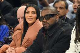 CHICAGO, ILLINOIS - FEBRUARY 16: (L-R) Kim Kardashian West, Kanye West, and J. Cole attend the 69th NBA All-Star Game at United Center on February 16, 2020 in Chicago, Illinois. (Photo by Kevin Mazur/Getty Images)