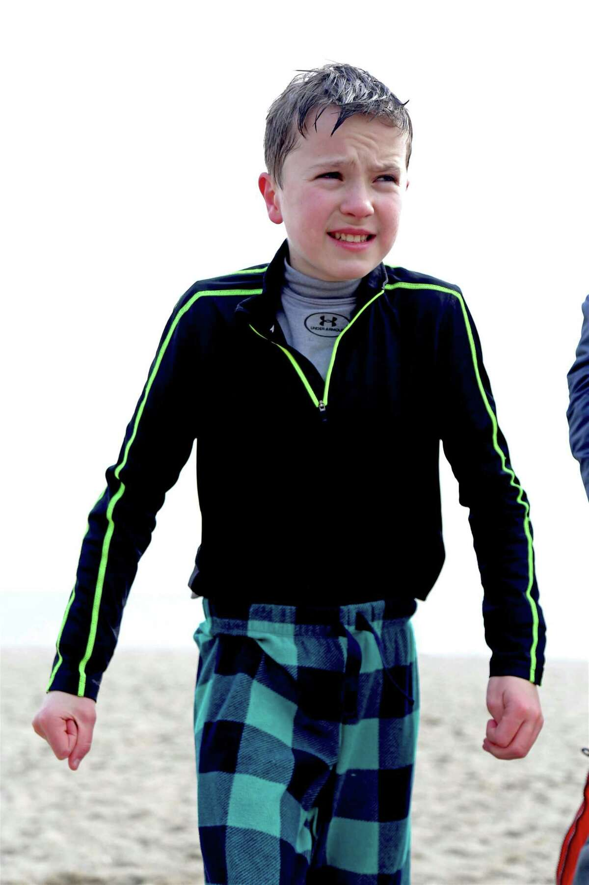 Charlie Lovett, 13, of Ridgefield, was the youngest participant at the 2nd annual Polar Bear Plunge, organized by Save the Children, at Jennings Beach on Sunday, Feb. 16, 2020, in Fairfield, Conn.