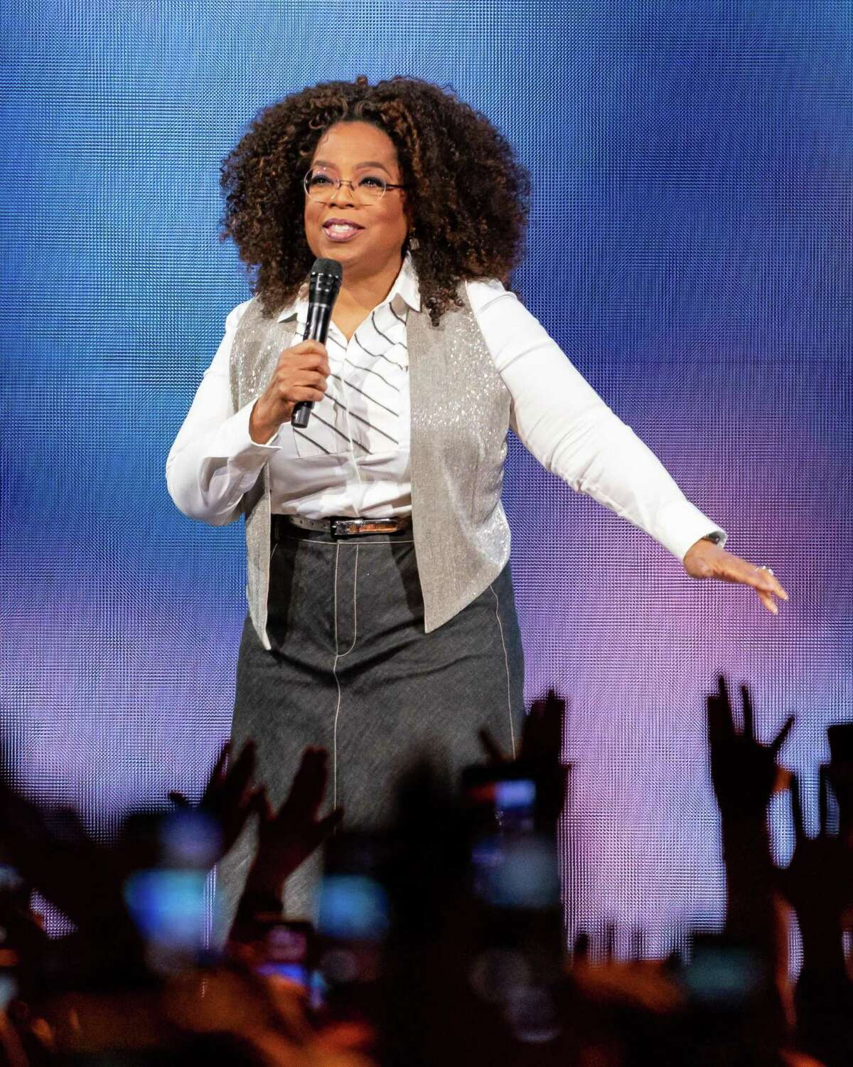 Oprah Winfrey speaks on stage during Oprah's 2020 Vision: Your Life in Focus Tour presented by WW (Weight Watchers Reimagined) at American Airlines Center on February 15, 2020 in Dallas, Texas. (Photo by SUZANNE CORDEIRO / AFP)