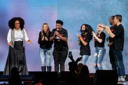 Oprah Winfrey speaks with the stars of Netflix's Cheers, (L-R) Monica Aldama, Jerry Harris, Gaby Butter, Lexi Brumback, TT Baker and Dillion Brandt during Oprah's 2020 Vision: Your Life in Focus Tour presented by WW (Weight Watchers Reimagined) at American Airlines Center on February 15, 2020 in Dallas, Texas. (Photo by SUZANNE CORDEIRO / AFP)