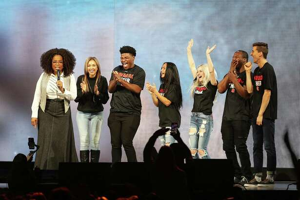 "DALLAS, TX - FEBRUARY 15: Oprah Winfrey speaks with the cast of Netflix's ""Cheer"", (L-R) Monica Aldama, Jerry Harris, Gabi Butler, Lexi Brumback, TT Barker and Dillon Brandt during Oprah's 2020 Vision: Your Life in Focus Tour presented by WW (Weight Watchers Reimagined) at American Airlines Center on February 15, 2020 in Dallas, Texas."