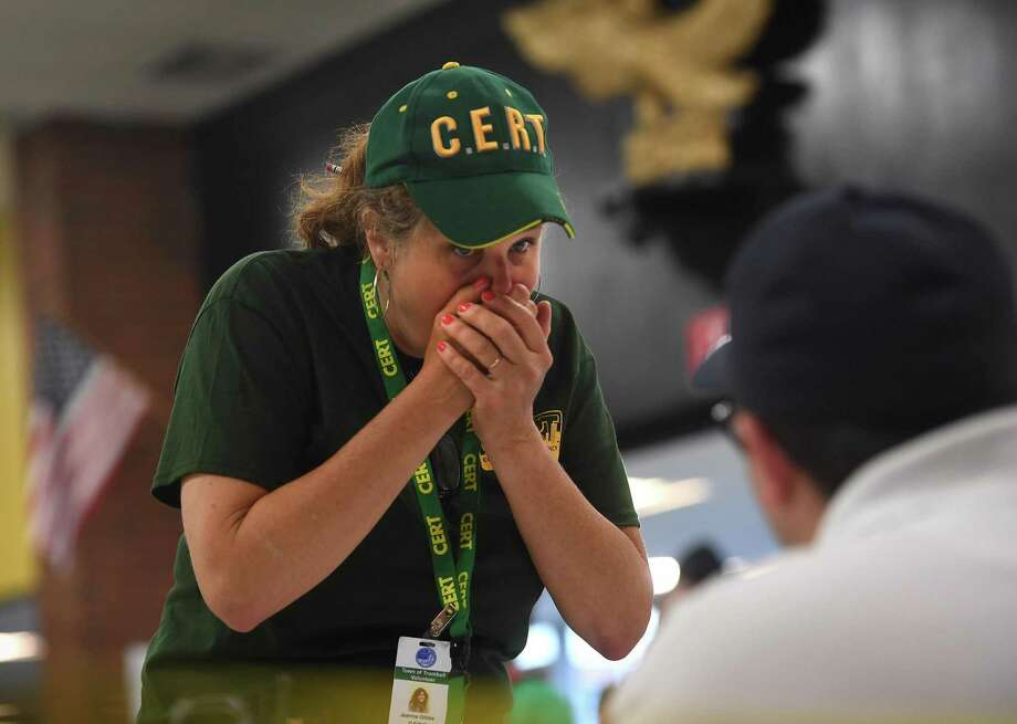 Community Emergency Response Team volunteer Jeanne Gibbs, of Trumbull, presents as a patient with symptoms of anthrax exposure at a multiple town drill for the mass dispersing of medication in response to an anthrax incident at Trumbull High School in Trumbull, Conn. on Tuesday, June 25, 2019. The drill, featuring Medical Reserve Corps volunteers from Trumbull, Stratford, and Monroe, simulated the dispensing of antibiotics in response to an anthrax incident on a Metro North train. Photo: Brian A. Pounds / Hearst Connecticut Media / Connecticut Post