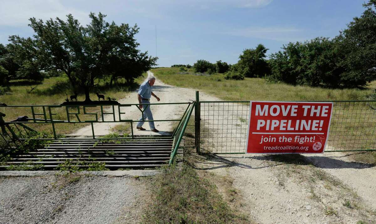 Andy Sansom walks on his property where a proposed new natural gas pipeline would pass through his ranch in the Texas Hill Country near Stonewall, Texas Friday, Aug. 2, 2019. The proposed 430-mile pipeline would move gas from the Permian Basin to the Houston area.