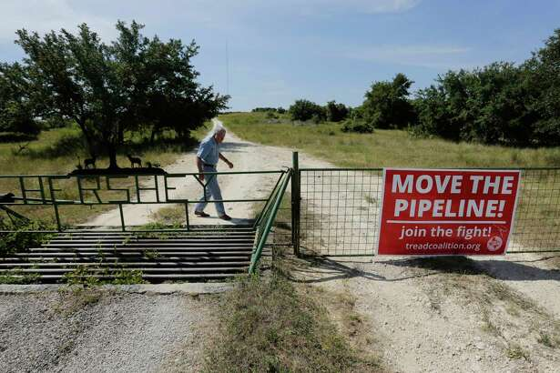 Andy Sansom walks on his property where a proposed new natural gas pipeline would pass through his ranch in the Texas Hill Country near Stonewall, Texas Friday, Aug. 2, 2019. A proposed pipeline is a 430-mile, $2 billion natural gas expressway that pipeline giant Kinder Morgan has mapped from the booming West Texas oil patch to Houston. (AP Photo/Eric Gay)