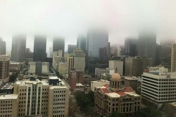 Fog hangs over downtown Houston Monday, Feb. 17, 2020.