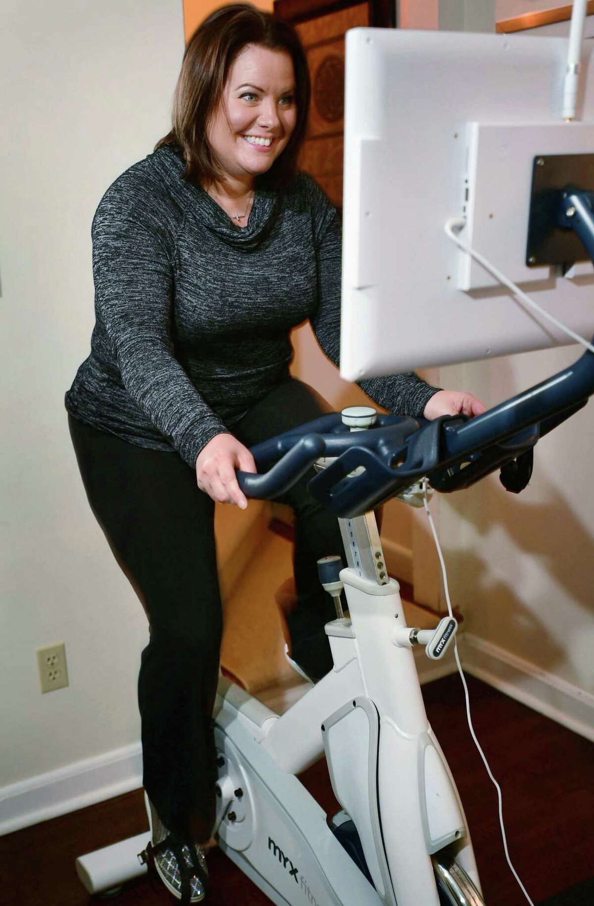 Norwalk resident Sara Pennella uses her Myx Fitness exercise bike Tuesday, February 11, 2020, ather home in Norwalk, Conn. Pennella is one of the first users of the exercise bikes made by Greenwich-based Myx Fitness.