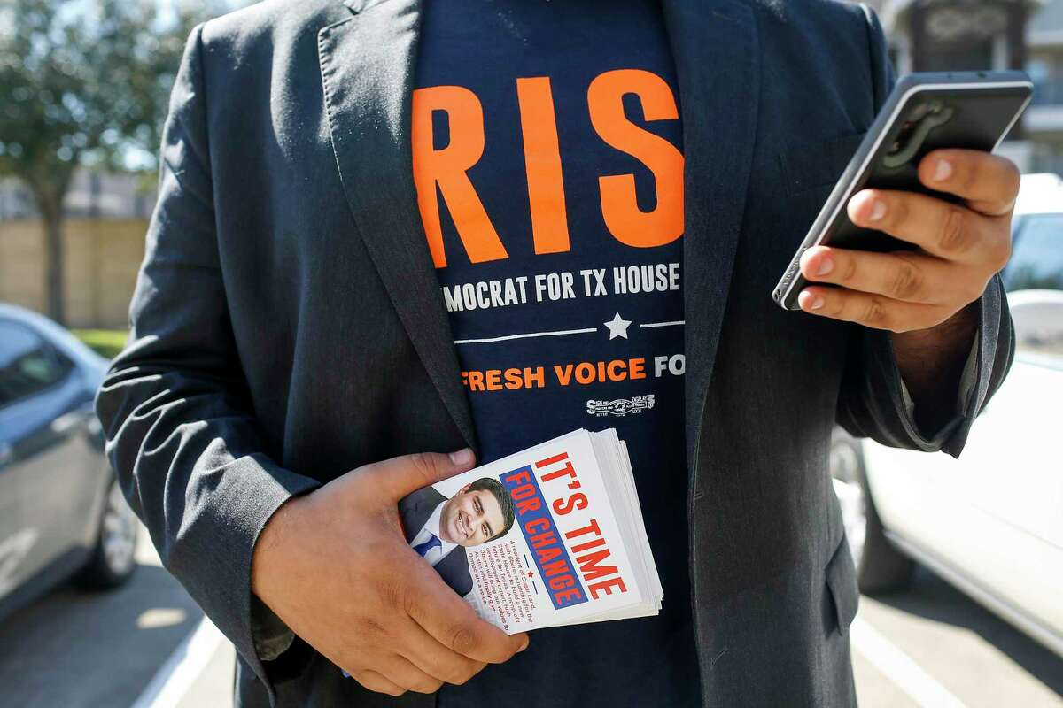 """Rish Oberoi, a Democratic candidate for Texas House District 26, checks unit numbers while door-knocking at the Marquis at Sugar Land apartments Thursday, Feb. 13, 2020, in Sugar Land. """"People ignore these complexes,"""" he said."""