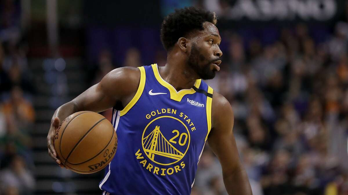 Golden State Warriors guard Jeremy Pargo (20) looks to pass against the Phoenix Suns during the second half of an NBA basketball game, Wednesday, Feb. 12, 2020, in Phoenix. (AP Photo/Matt York)