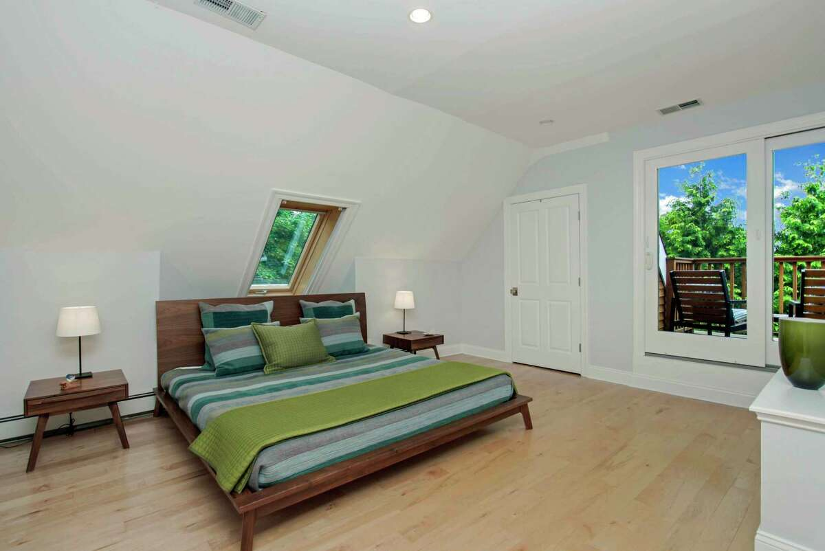 On the third floor there are two bedrooms, both have a skylight and one has sliding doors to a private balcony/deck.