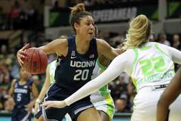 UConn's Olivia Nelson-Ododa, left, drives against South Florida's Kristyna Brabencova during on Sunday in Tampa, Fla.