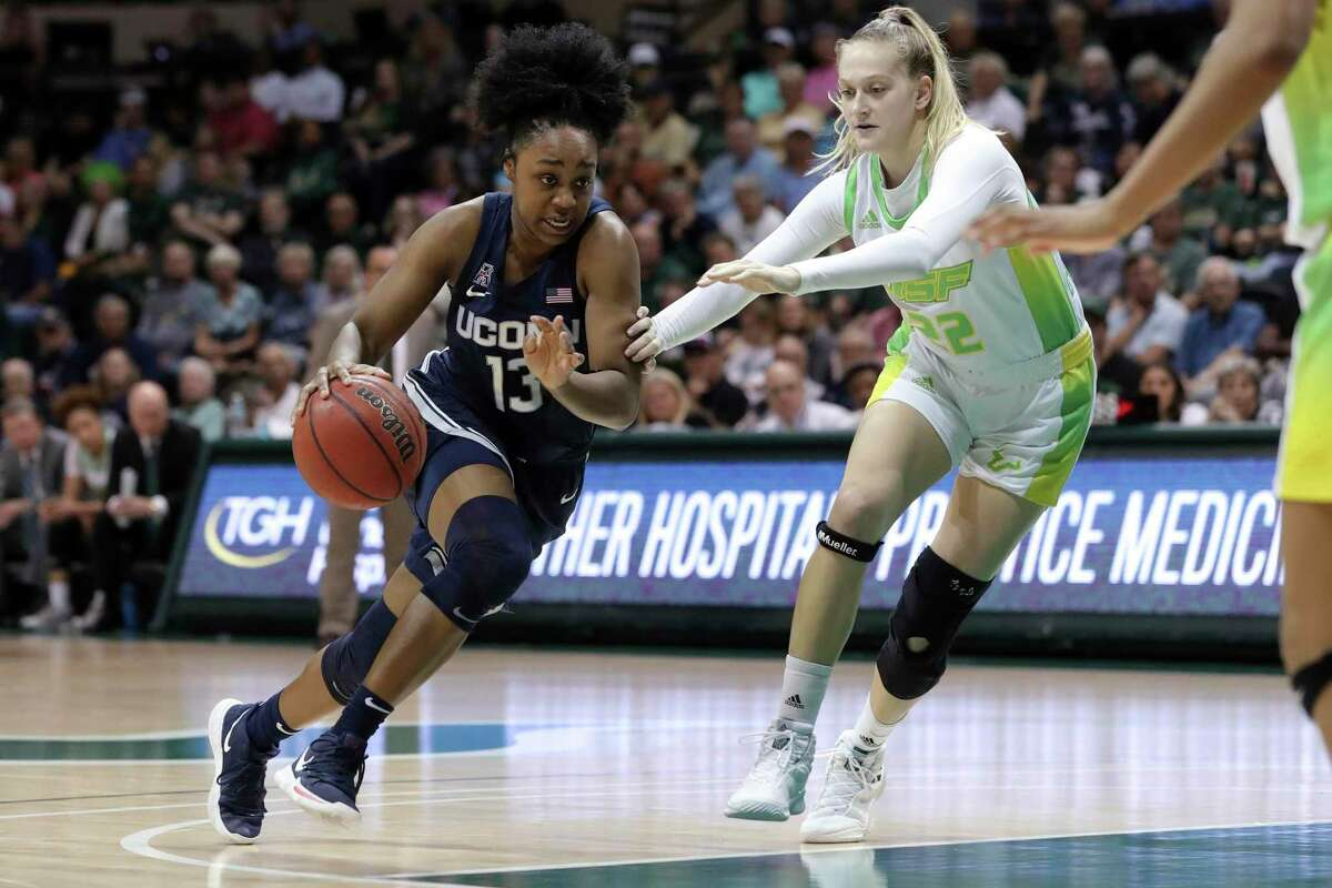 UConn's Christyn Williams, left, drives past South Florida's Kristyna Brabencova during the second half of an NCAA college basketball game Sunday, Feb. 16, 2020.