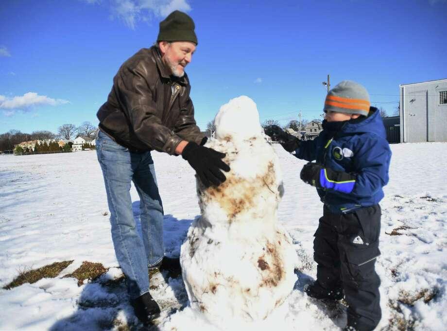 Glenn Baum, of Buffalo, NY, builds a snowman with his grandson Oliver Baum, 5, of Milford, at Ray O'Connor Memorial Field in the Walnut Beach section of Milford, Conn. on Sunday, Jan. 19, 2020. It was one of the few times for measurable snow this winter. Based on readings at Sikorsky Memorial Airport in Stratford, this winter's current snow total of 10.1 inches is seven inches below the normal amount by mid-February Photo: Brian A. Pounds / Hearst Connecticut Media / Connecticut Post