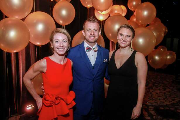 EMBARGOED FOR SOCIETY REPORTER UNTIL FEB. 20 Jenny Craven, from left, Ben Northrup and Kristin Devlin at the Heart Association's annual Heart Ball at the Hilton Americas Houston on February 15, 2020.