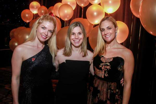 EMBARGOED FOR SOCIETY REPORTER UNTIL FEB. 20 Lydia Davies, from left, Molly Stone and Jennifer Ban at the Heart Association's annual Heart Ball at the Hilton Americas Houston on February 15, 2020.