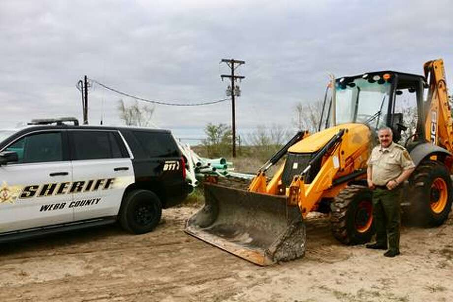 Webb County Sheriff Martin Cuellar is pictured with a recovered 2015 Backhoe valued at $75,000. Photo: Courtesy
