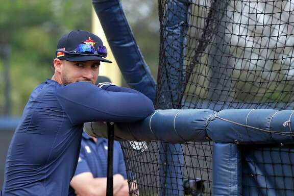 Houston Astros outfielder George Springer watches batting practice during the first full-squad Houston Astros spring training workout at the Fitteam Ballpark of The Palm Beaches, in West Palm Beach , Monday, Feb. 17, 2020.