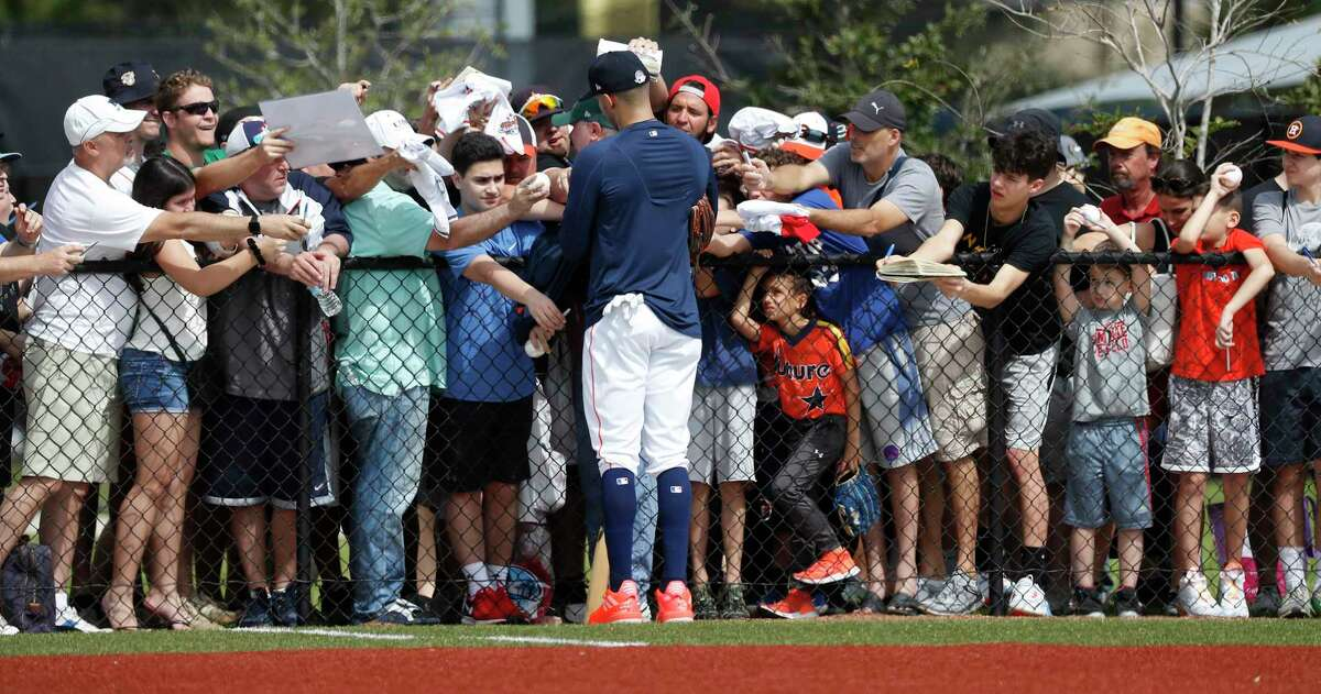 Houston Astros infielder Carlos Correa signs autographs for fans after finishing the first full-squad Houston Astros spring training workout at the Fitteam Ballpark of The Palm Beaches, in West Palm Beach , Monday, Feb. 17, 2020.