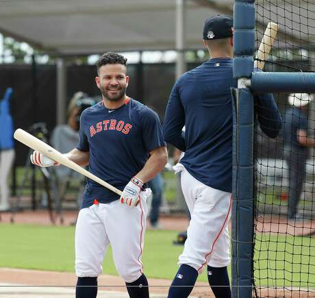 Houston Astros Jose Altuve switches places with Carlos Correa as they took batting practice during the first full-squad Houston Astros spring training workout at the Fitteam Ballpark of The Palm Beaches, in West Palm Beach , Monday, Feb. 17, 2020.