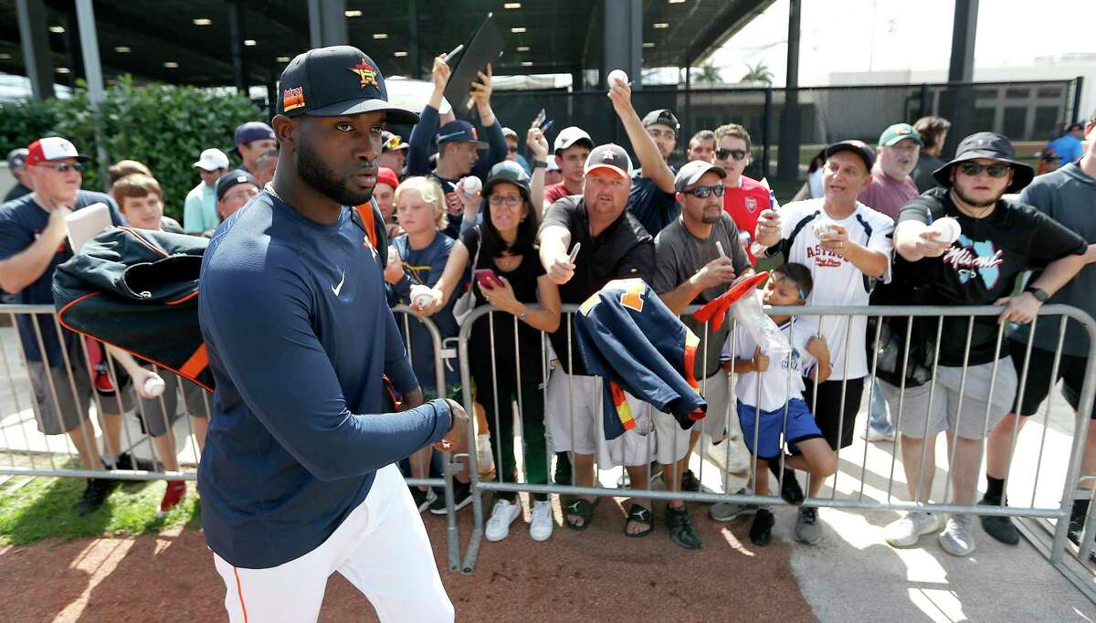 Fans scream for autographs as Houston Astros outfielder Yordan Alvarez (44) changes fields during the first full-squad Houston Astros spring training workout at the Fitteam Ballpark of The Palm Beaches, in West Palm Beach , Monday, Feb. 17, 2020.