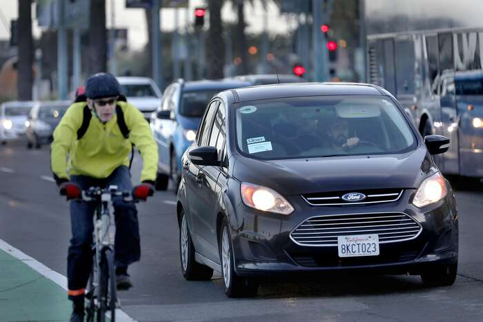 An Uber car waits at a traffic light on the Embarcadero at Mission St. on Wednesday, Jan. 29, 2020, in San Francisco, Calif.