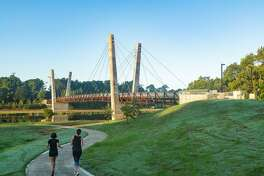 A footbridge over Brays Bayou at Mason Park is among the many Bayou Greenways 2020 projects. The Kinder Foundation has devoted $50 million to the Houston Parks Board's huge effort, focused now mostly on land acquisition for new public greenspace outside Loop 610.