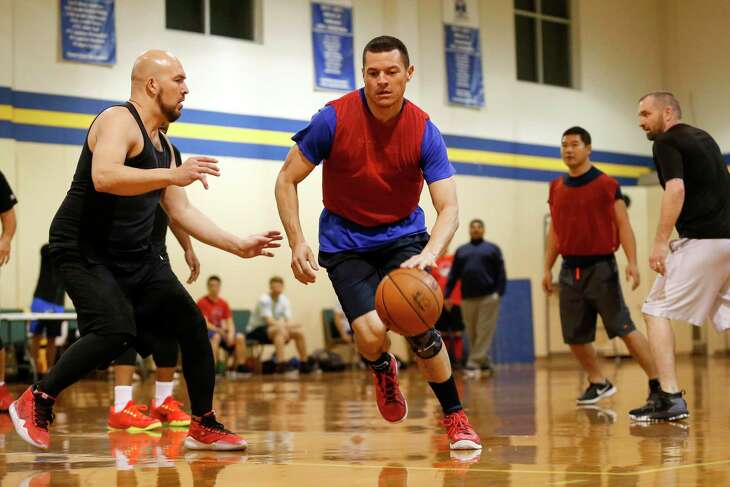 Fr. Preston Quintela drives to the basket defended by Noel Yeppez during a practice for the Priests vs Seminarians game.